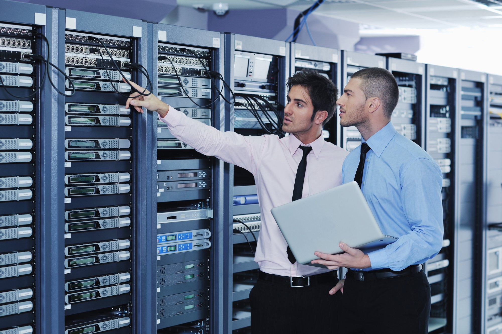IT consultants working in a server room